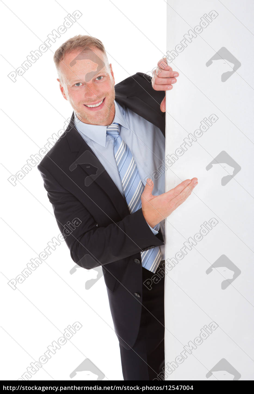 confident, businessman, showing, billboard - 12547004