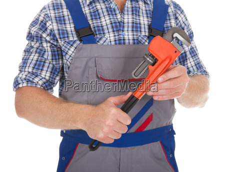 handyman, holding, adjustable, wrench - 12547344