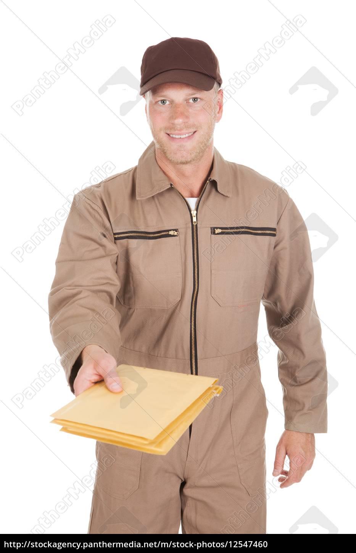 postman, giving, envelopes, over, white, background - 12547460