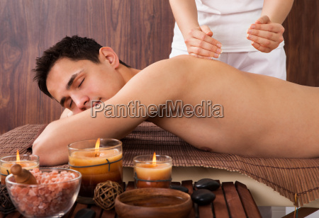 relaxed, man, receiving, shoulder, massage, in - 12547986