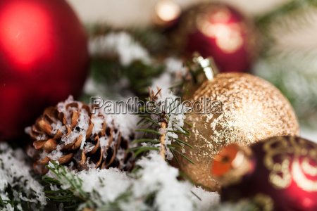 red christmas balls between cones and