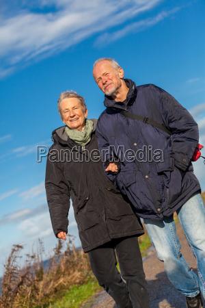 senior happy couple makes a walk