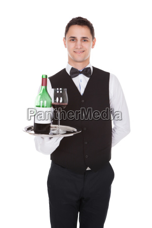 waiter holding tray with glass of