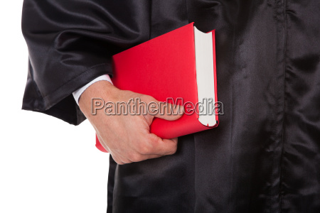 male judge holding statute book