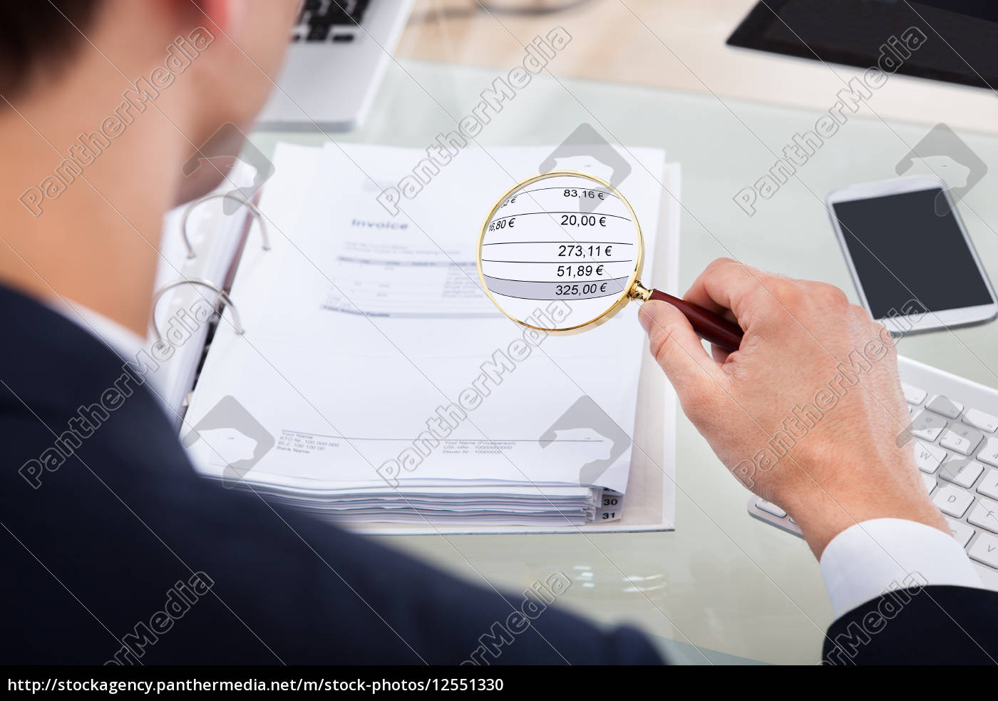 auditor, examining, invoice, with, magnifier - 12551330