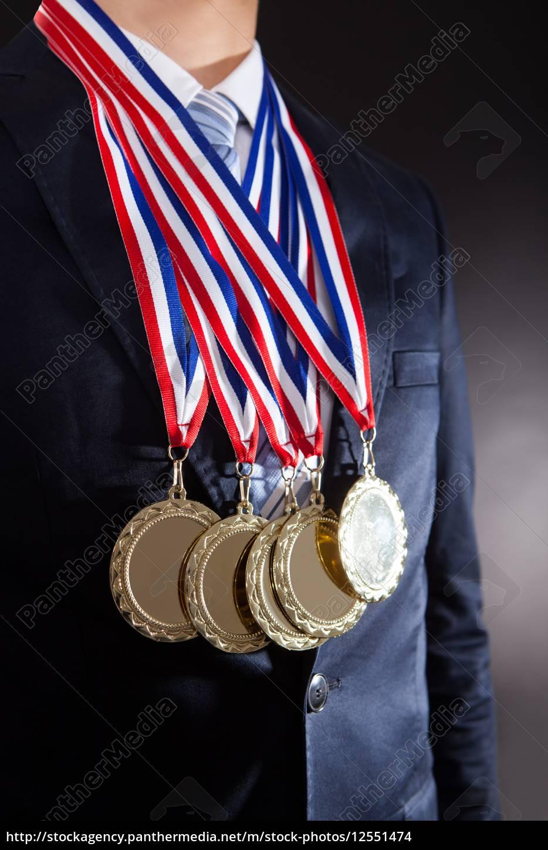 businessman, wearing, gold, medals - 12551474
