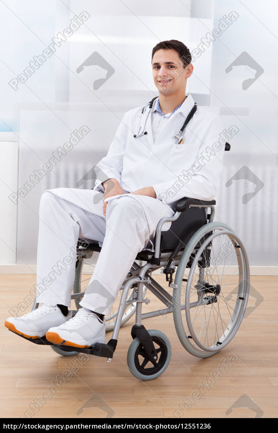 handicapped, doctor, sitting, on, wheel, chair - 12551236