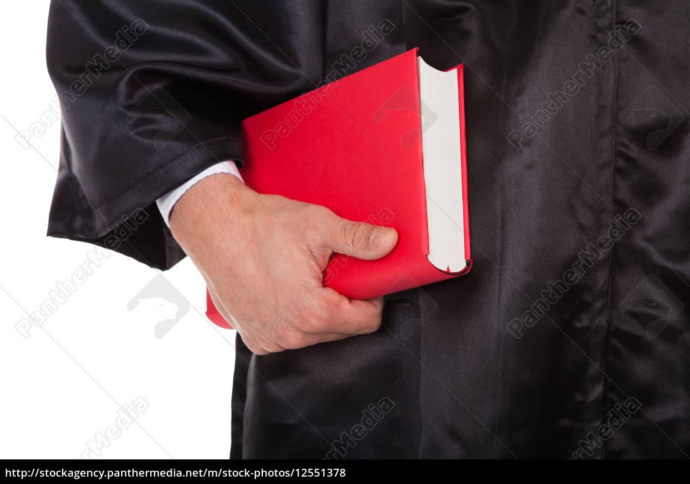 male, judge, holding, statute, book - 12551378