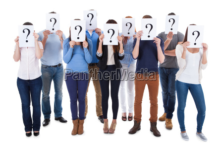 diverse group of people holding question