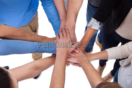 group, of, people, stacking, hands, together - 12552716