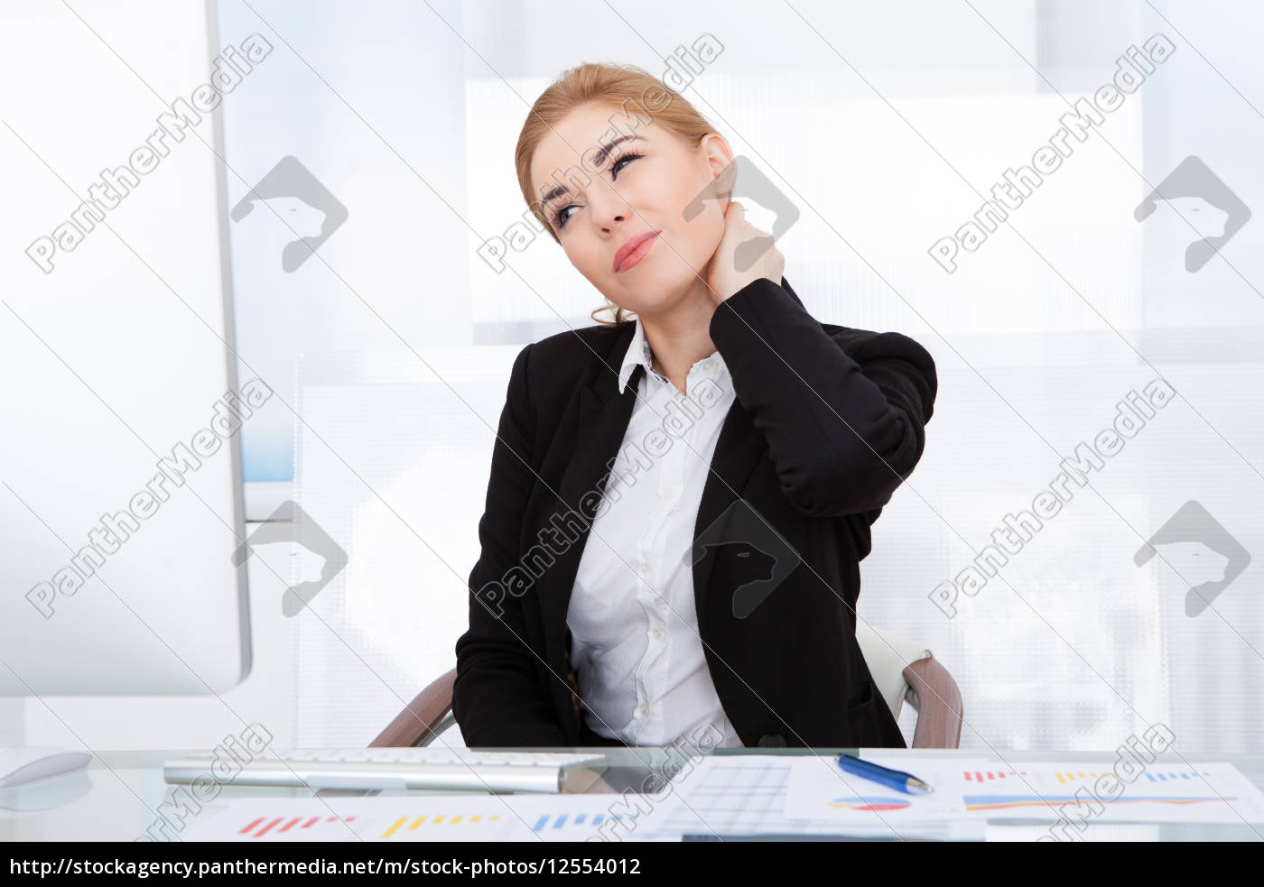 businesswoman, suffering, from, neck, pain - 12554012