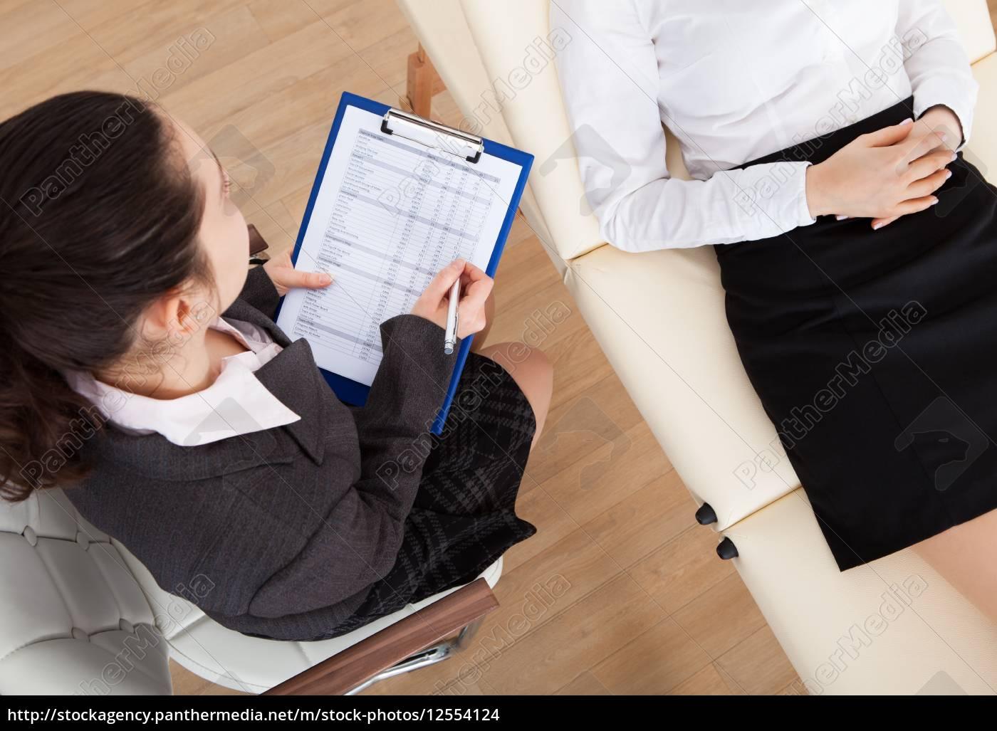 psychiatrist, examining, patient - 12554124