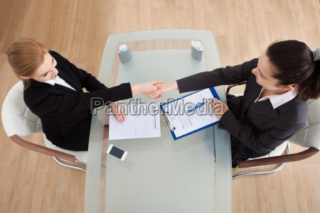 two, businesswoman, shaking, hand - 12554088