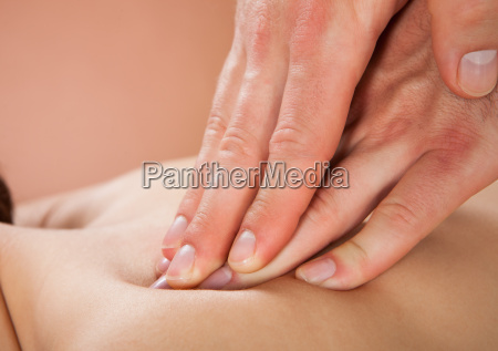 therapist massaging female customers back at