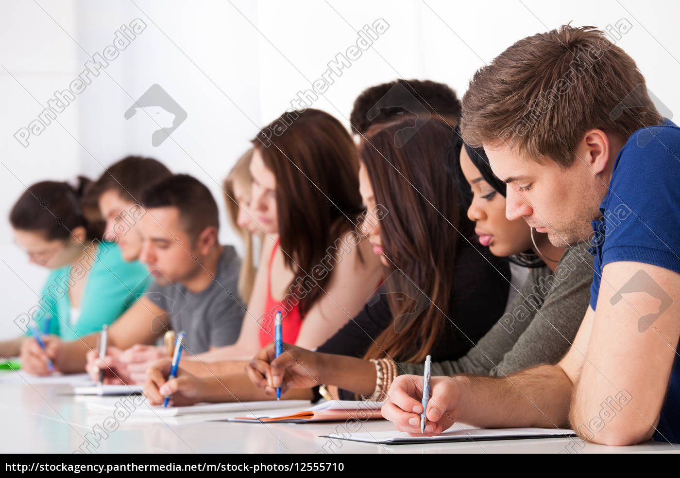 row, of, college, students, writing, at - 12555710