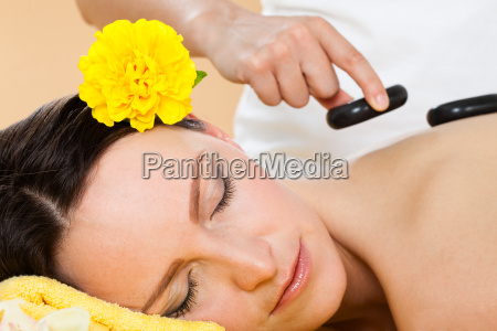 woman, receiving, hot, stone, therapy, in - 12555068