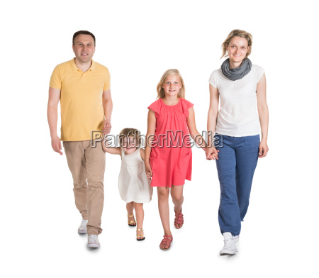 happy young family walking together