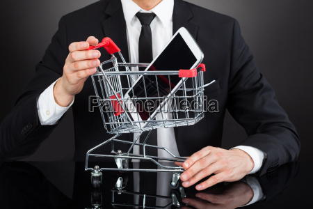 businessman with shopping cart model and