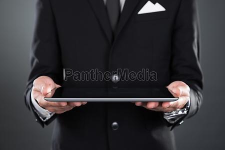 businessman, holding, digital, tablet - 12556990