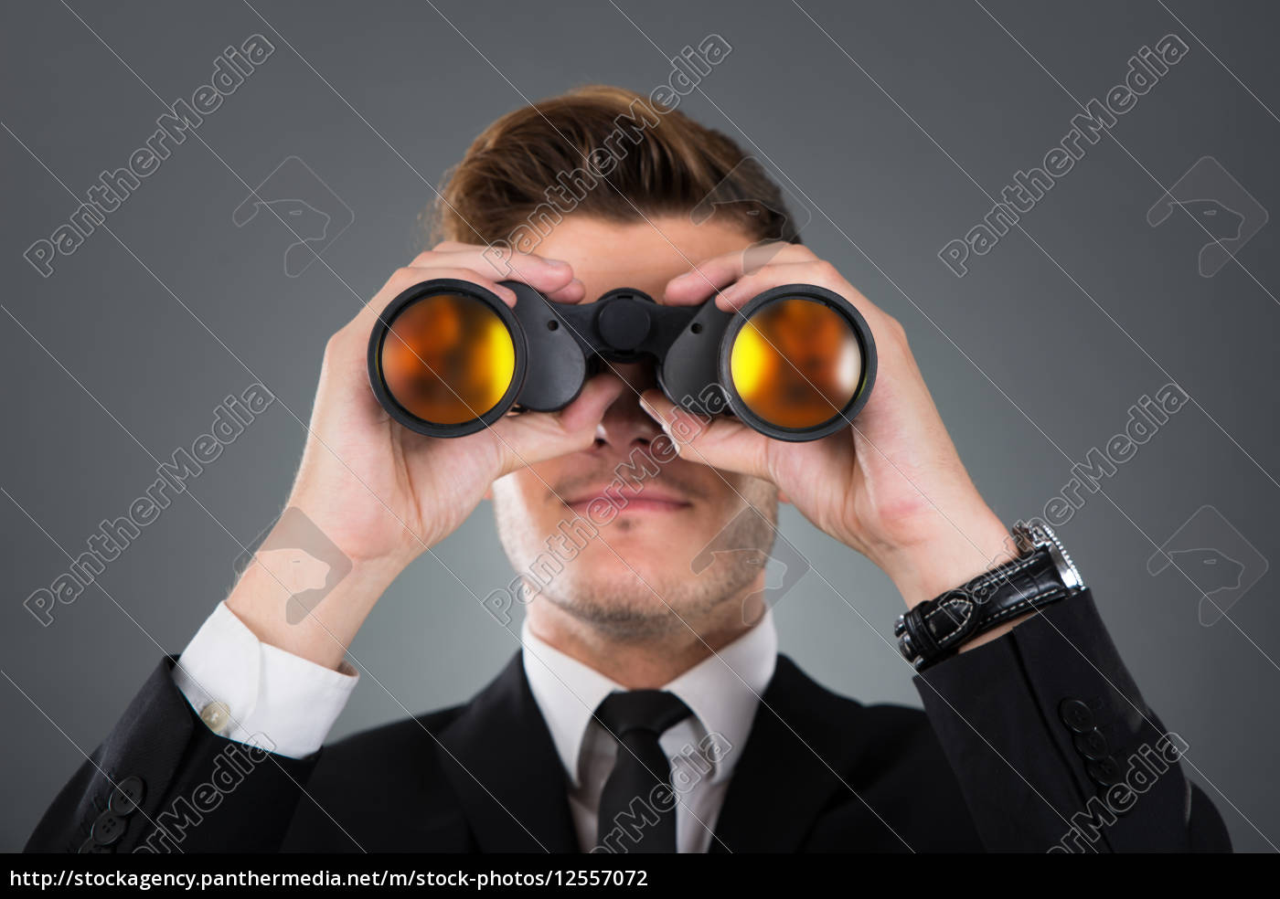 businessman, looking, through, binoculars - 12557072