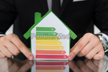 businessman, showing, energy, efficient, chart, on - 12557312
