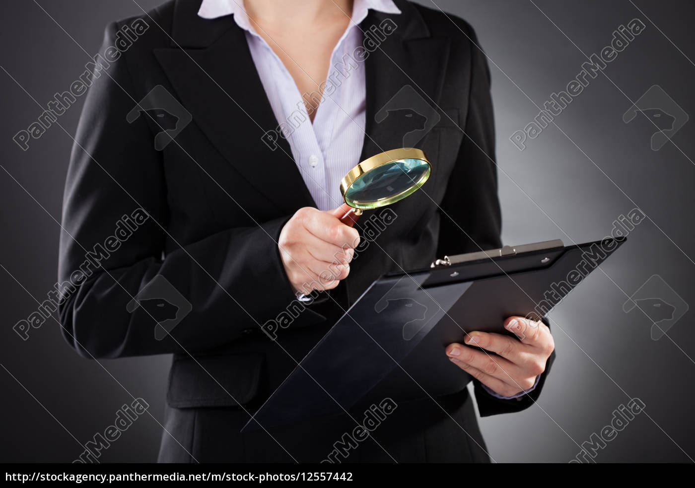 businesswoman, with, , magnifying, glass, and - 12557442
