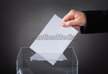hand, putting, ballot, in, box - 12557452