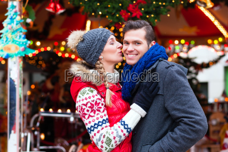 couple on the christmas market during