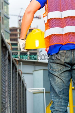 worker on construction site with helmet