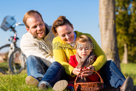 family gathering chestnuts in autumn