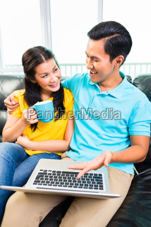 asian, couple, using, laptop - 12558732