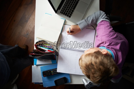 overhead view of boy studying in