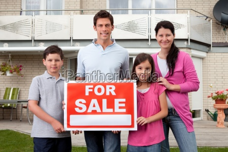 family selling their home holding for