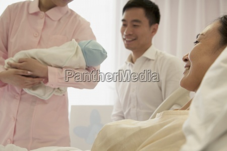 childbirth new life three people young