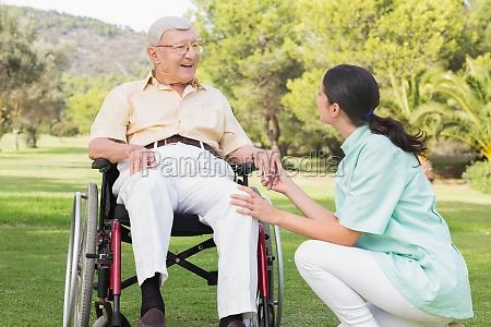 elderly man in wheelchair and brunette