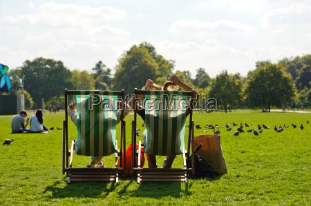 in deckchair relaxing in hyde park