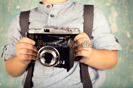 little boy with camera retro