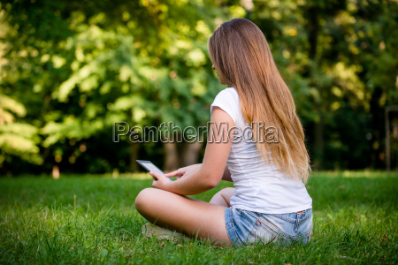 teen girl with book reader