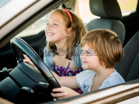 children driving car