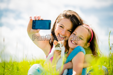 selfie mother child and kitten