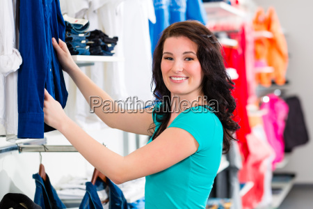 woman buys clothes in shop