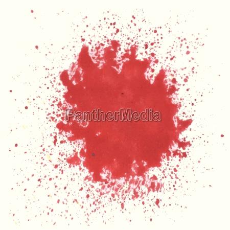 red watercolor blot