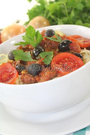spaghetti alla puttanesca with parsley