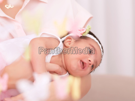 newborn girl with mother