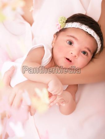 newborn girl on mothers hands