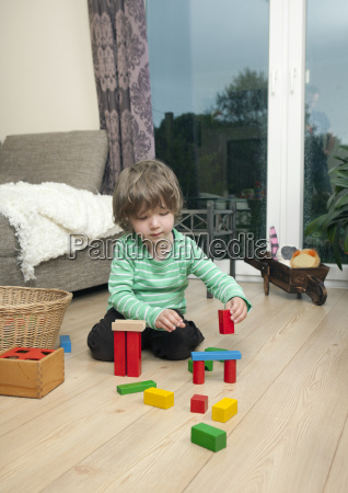 boy playing on the flooring