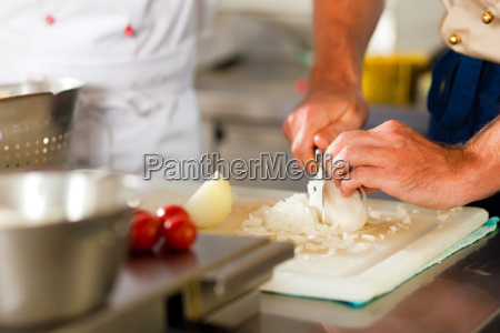 cook cooks in restaurant or hotel