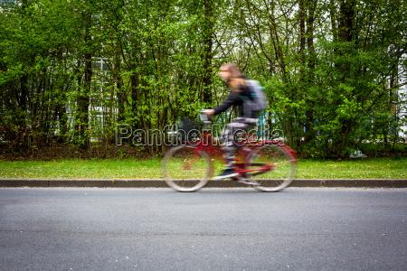 motion blurred female biker on a