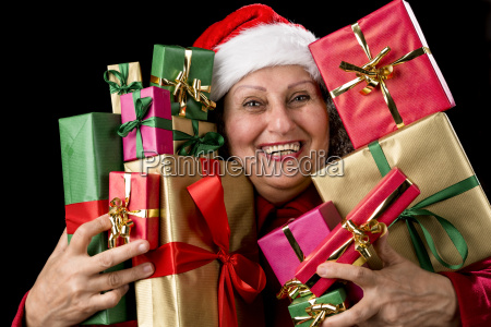 cheerful female senior embosoming wrapped gifts