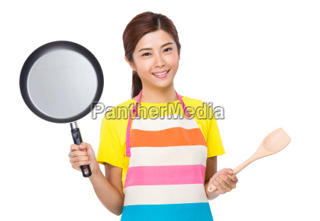 asian housewife with cooking tool